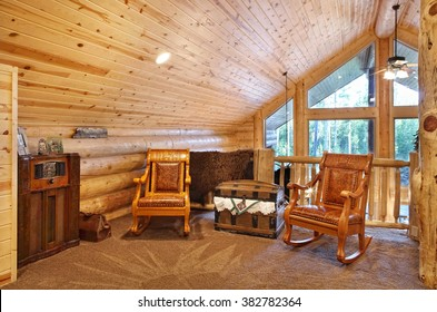 A luxurious loft with comfortable furnishings, in a modern log cabin in the mountains.