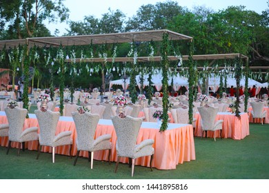 luxurious Long dinner tables and chairs, rich decorated with flowers , Indian Wedding arrangement setup - Image