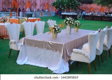 luxurious Long dinner tables and chairs, rich decorated with flower pots, Indian Wedding setup celebration - Image