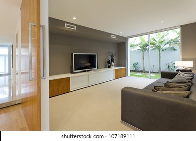 Luxurious media room with Tv and couch
