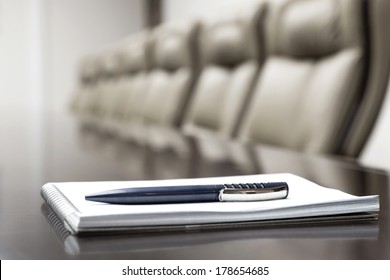 luxurious meeting room in a big corporation is sepia style with agenda notepad for conference