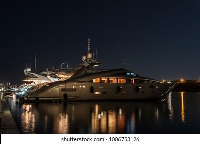 Luxurious modern yacht, Marina di Portisco, Sardinia, Italy. Night photography.