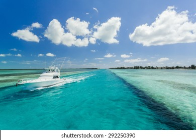 Luxurious motor boat in the Bahamas with turquoise water and blue sky
