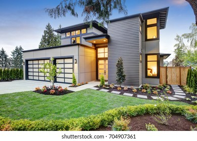 Luxurious new construction home in Bellevue, WA. Modern style home boasts two car garage spaces and well manicured front yard. Northwest, USA