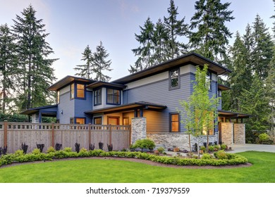 Luxurious new home with curb appeal. Trendy grey two-story mixed siding exterior in Bellevue with well manicured front yard. Northwest, USA
