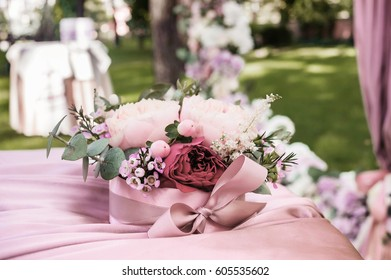 Luxurious pillow for wedding rings with fresh flowers. Wedding details