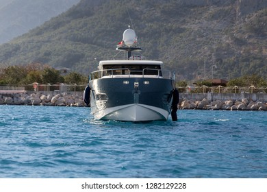 A luxurious powerboat cruising through beautiful blue waters.Front View