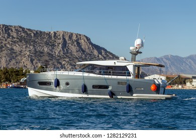 A luxurious powerboat cruising through beautiful blue waters. Side view