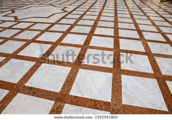 luxurious red and white marble floor; abstract square pattern