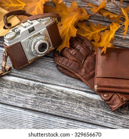 Luxurious set of leather gloves, wallet and retro camera