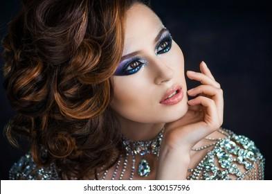 Luxurious sexy young beautiful girl in jewelry