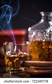 Luxurious smoking cuban cigar in ashtray.