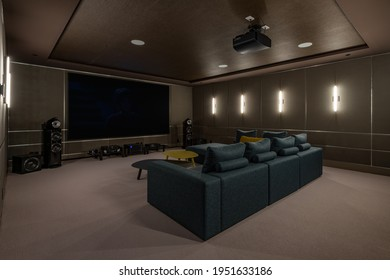 Luxurious theater room with large screen and lighting