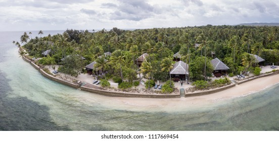 A luxurious tropical resort looks out on a beautiful reef flat in Wakatobi National Park, Indonesia. This area harbors an amazing array of marine biodiversity and is within the Coral Triangle.