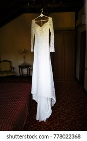 Luxurious and very beautiful white wedding dress for the perfect slender bride figure of a girl