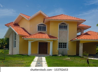 Luxurious villa in Dominican Republic. Beautiful villa with an own swimming pool. villa on luxury Caribbean resort with beautiful garden. Classical spanish villa among flowers, not far from ocean.