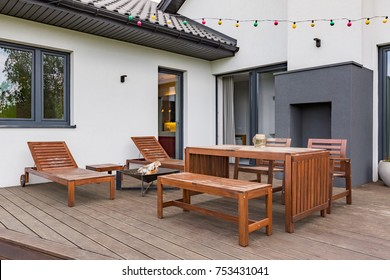 Luxurious villa with patio with wooden furniture set