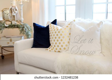 Luxurious white sofa with Christmas cushion and ornaments.