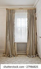 Luxurious window coverings of a home interior