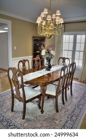 Luxurious wooden dining room table and chairs in a modern home.