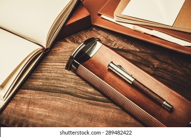 Luxurious writing tools on a wooden table
