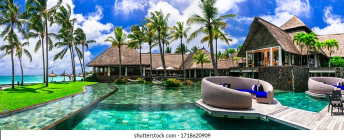 luxury 5 star hotel territory with swimming pool and bar zone - Constance Belle Mare Plage. Mauritius island. Pointe de flacq , Belle Mare. February 2020