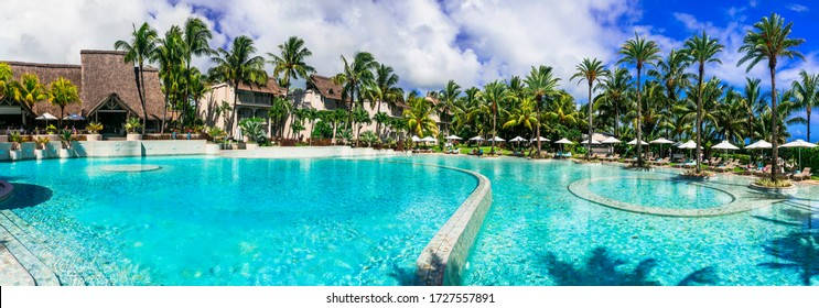 luxury 5 star resort territory with swimming pool and hotel rooms - Lux Bell mare resort. Mauritius island. Coastal Road, Belle Mare. February 2020