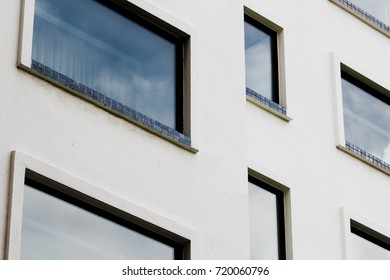 Luxury Apartment Building ,Detail shot of patterned wall,Architectural feature, windowed corner of office building,