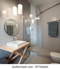 Luxury apartment, modern bathroom with round mirror