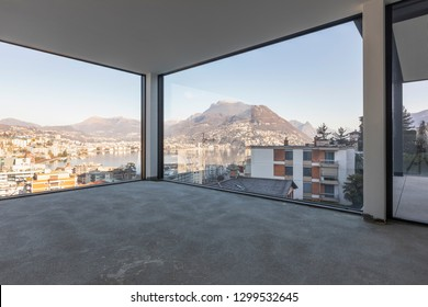 Luxury apartment overlooking the city under construction. Nobody inside, concrete floor