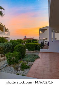 Luxury apartments in Cyprus in Peyia (Paphos). House with pool and garden at sunset