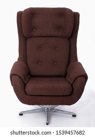 Luxury armchair made of tubes and brown padding. Massive, spinning, sewn chair. On white background.