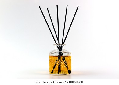 luxury aroma scent reed diffuser glass bottle is on the white table to creat romantic and relax ambient in the bedroom with white cement wall background in the morning for happy valentine day