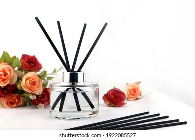 ชื่อผลงาน: luxury aroma scent reed diffuser glass bottle is on the white table with roses flowers to creat romantic and relax ambient in the bedroom with white cement wall background on the happy vale