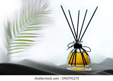 luxury aroma scent reed diffuser glass bottles are on the table with table runner to creat romantic and relax ambient in the bedroom with white wall background in the morning for happy valentine day