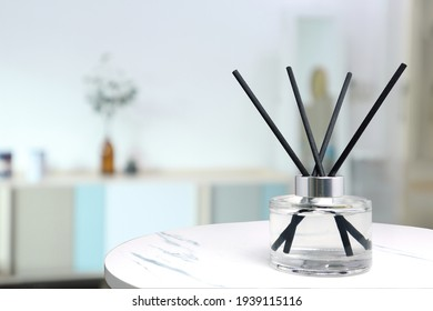 luxury aromatic scent of reed diffuser glass bottle is used as room freshener on the white marble table in the minimal design decoration bedroom to creat relax and romantic ambient in the morning