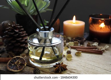 luxury aromatic scented reed diffuser or air freshener decorated on wooden table in the living room of the house during Christmas new year party celebration