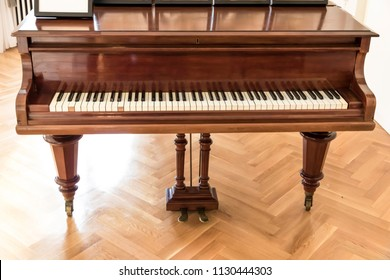 Luxury ballroom with old piano.