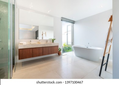 Luxury bathroom features basin and bathtub home, house ,building