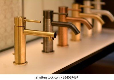 Luxury bathroom. Gold faucet. Golden faucet. Faucet isolated. Sink faucet. Bathroom faucets. Gold tap