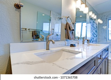 Luxury bathroom interior with blue dual washstand and marble counter top.