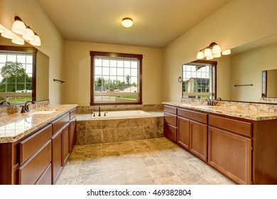 Luxury bathroom interior with granite trim and two vanity cabinets. Northwest, USA