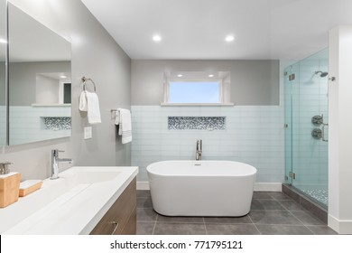 Luxury bathroom interior with an oval bathtub stone tiles and with glass shower