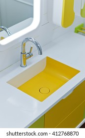 Luxury bathroom with yellow details and ornaments