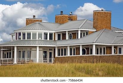 Luxury beach house in dune grass.