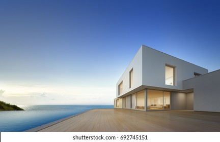 Luxury beach house with sea view swimming pool and empty terrace in modern design, Vacation home for big family on blue sky background - 3d rendering of residential building