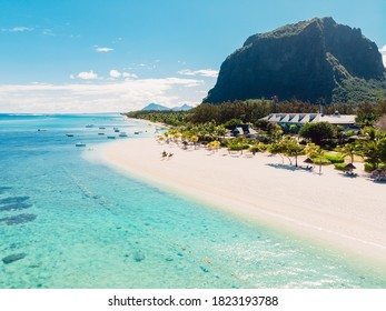Luxury beach in Mauritius. Tropical beach with palms and transparent ocean. Aerial view