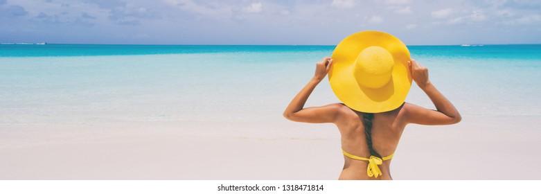 Luxury beach travel - Sexy woman sunbathing on the beach with bikini beach body. Beautiful multiracial Asian Caucasian female model on travel vacation holidays.