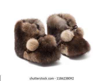 Luxury beautiful brown baby shoes, boot, slippers, home shoes, made of natural fur, on white background