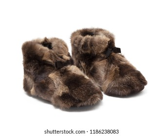 Luxury beautiful brown shoes, boot, slippers, home shoes, made of natural fur, on white background